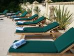 Sunloungers for relaxing on the secluded terrace by the pool