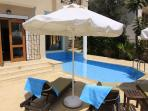cushioned sunbeds by the private freshwater pool