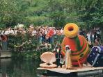 Floral 'float past' entrant in the Epeluche Boat Festival, held on the last weekend in Aug