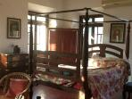 The antique cherry four poster bed in the master bedroom