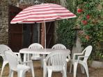 Outside area with patio table and chairs,parasol,bbq