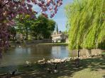 Visit market towns like Bakewell with river walks, tea shops, Bakewell pudding, independent shops