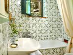 The en suite bathroom, with tiles hand painted by the owner.