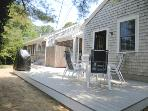 Deck with gas grill, outdoor dining and outdoor enclosed shower