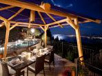 Roof terrace dining at night