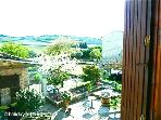 Wonderful view of the gardens and  hills, vines and sunflowers beyond from cottage bedroom window