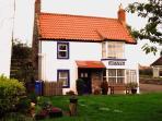 Britannia House and village green
