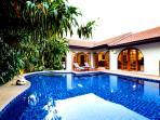 day photo 0f pool and villa