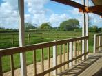 Verandah overlooking the garden, orchard and meadow