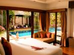 Bedroom n2 with views to the pool and tropical garden