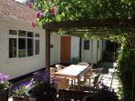 2 bedroom modern cottage-private garden area & only 30 steps from the seafront.