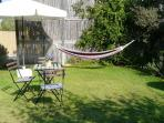 Sea cabin's private garden with spice garden and hammok