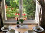La Source Tranquille - the dining area with views of the source and the garden