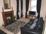 3 and 2 seater leather sofas,flat sceen tv,dvd with freeview