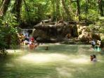 Swimm and relax at Erawan 7 tier waterfalls in a peaceful jungle forest