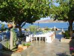 A wedding breakfast table overlooking the bay from the taverna at Pomos.