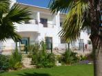 QUIET AND SUNNY GROUND FLOOR APT, SEA VIEW + POOL, EASY WALK TO BEACH, MARINA & TOWN, QUALITY Wi Fi