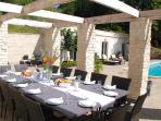 Dining under the pergola overlooking the pool