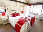 Bedroom with kingsize bed. Views over looking the village green. Light and airy.