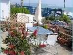 Relax outside with a refreshment and wonderful sea views