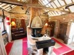 The Living Area - beautifully beamed and full of character with wood burning stove.