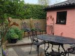 Patio area. Teak steamers and parasol for the summer. BBQ for the summer evenings.