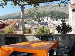 Secluded terrace overlooking orange rooftops of the Old City