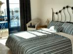 Master bedroom, with King Size bed, ensuite and balcony with sea views.