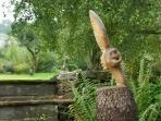 A sculpture of an owl adds interest to the garden