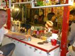 Buy cheap drinks at a street bar