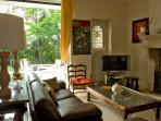 Hiru Anaiak- Living room and fireplace- the terrace at the back