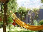 Backyard with hammock facing the Sandia Mountains.