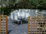 Patio and barbeque area at the rear of the garden