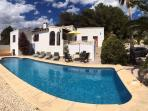 Panoramic view of the pool and house