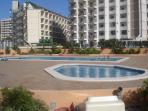 Swimming pool with kids pool and ample sunbathing area