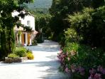 Entering the property, large flowery gardens and terraces