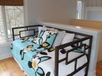 Waking up with great views from this upper loft is sure to be a very relaxing experience. Accomodates two with day bed...