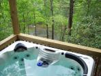Unwind in the hot tub overlooking the river