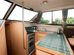 Fully equipped galley with full size cooker and fridge