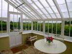 Conservatory with field and garden views - great for summer dining