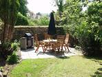 Fantastic private sheltered sun trap, located in the garden, perfect for enjoying a glass of wine.