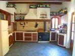 The country kitchen with dishwasher, electric fan oven, gas hob, fridge freezer, microwave, toaster.
