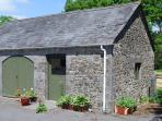 This old cart house now has washing machines and tumble dryer for guests to use