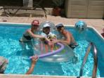 Family - playing in the swimming pool