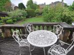 Balcony on upper level with view over private, enclosed garden to rear of property