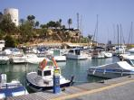 The marina and restaurants at nearby Cabo Roig.