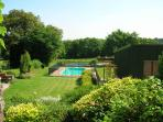 view across the gardens to the pool