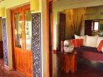 Elegant plantation doors from the living area onto the terrace.