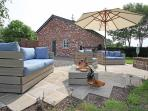 Nice garden with umbrella and sofas