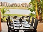 The extended Dining Table for 8 persons on the terrace looking out to the lake/golf.